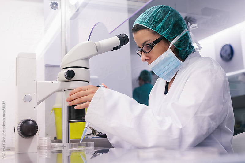 Young Woman Working in an Assisted Reproduction Laboratory by VICTOR TORRES for Stocksy United