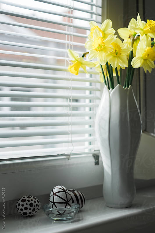 Spring Flowers in a Vase Next to the Window by Mosuno for Stocksy United