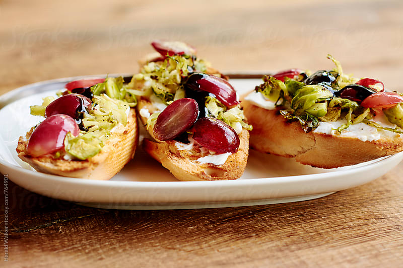 Roasted Brussels Sprouts and Grape Bruschetta by Harald Walker for Stocksy United