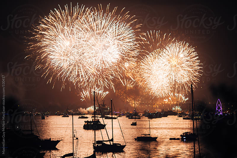 Fireworks over water by Maximilian Guy McNair MacEwan for Stocksy United