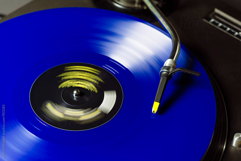 Blue record on turntable by Harald Walker for Stocksy United