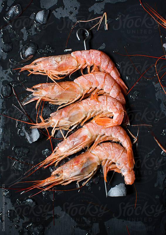 Skewer of fresh shrimp by Davide Illini for Stocksy United