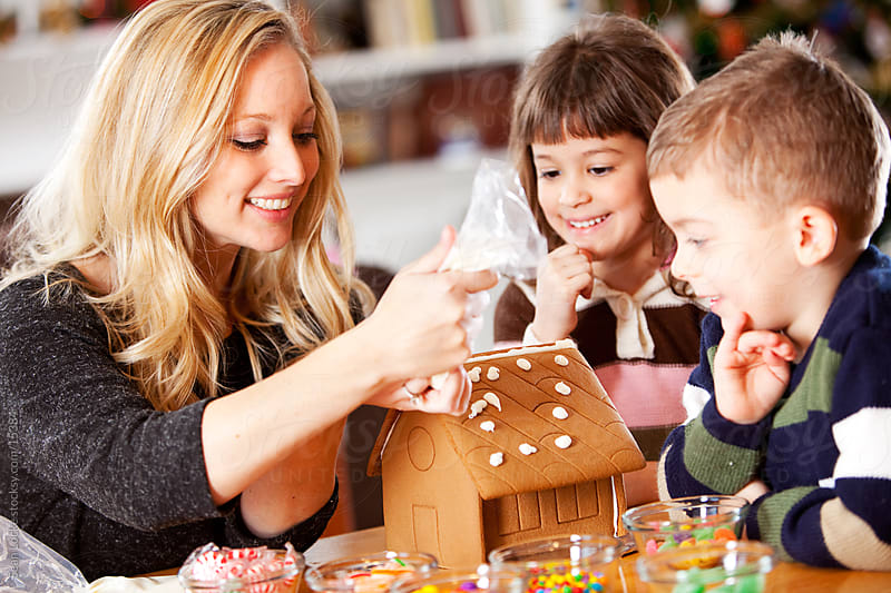 Gingerbread: Mom Shows Kids How to Build House by Sean Locke for Stocksy United
