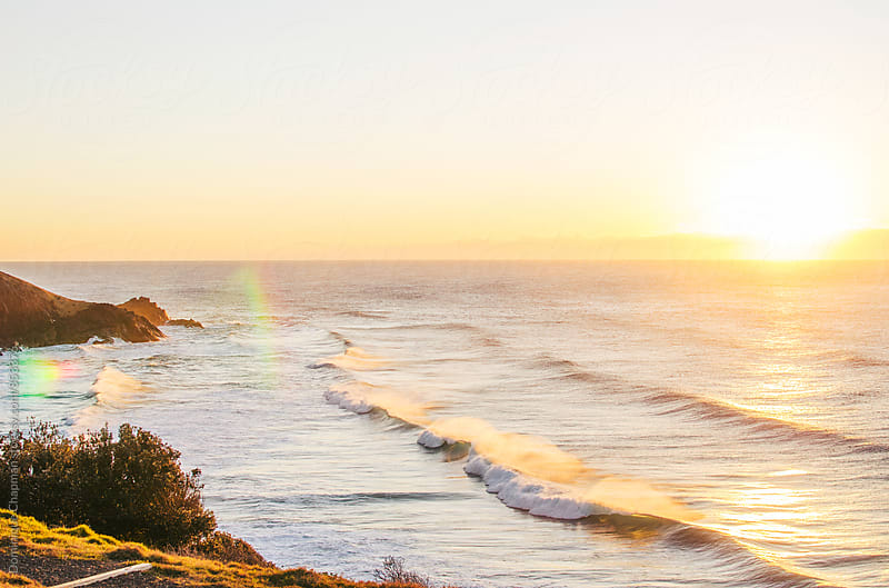 Sunrising over the ocean by Dominique Chapman for Stocksy United