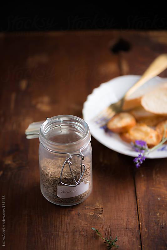 a jar of cumin seeds  by Laura Adani for Stocksy United