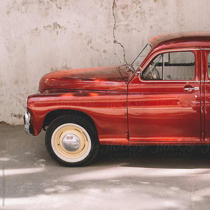 part of a red classic vintage car  by Alexey Kuzma for Stocksy United