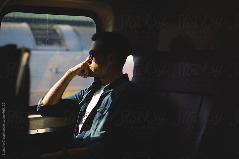 Man on a train trip by Leandro Crespi for Stocksy United