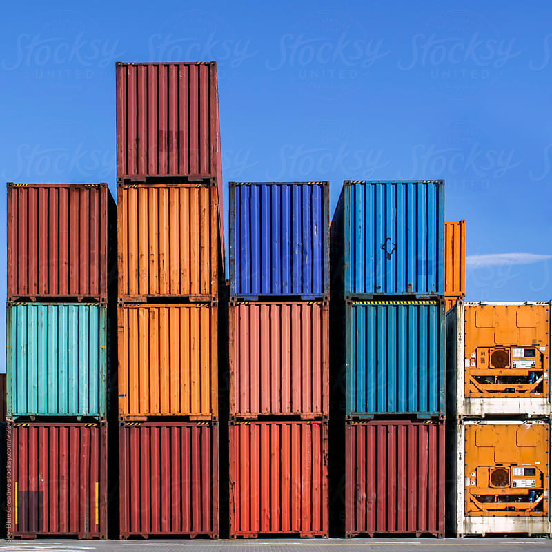 Stacked cargo containers in storage area of freight sea port terminal by Luca Pierro for Stocksy United