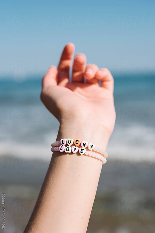 Lucky and Love bracelet by Simone Becchetti for Stocksy United