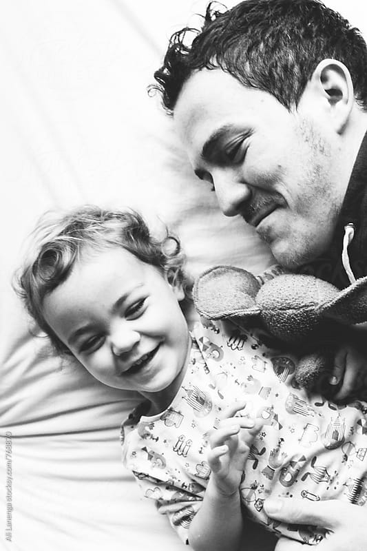 Father and Daughter Tickling by Ali Lanenga for Stocksy United