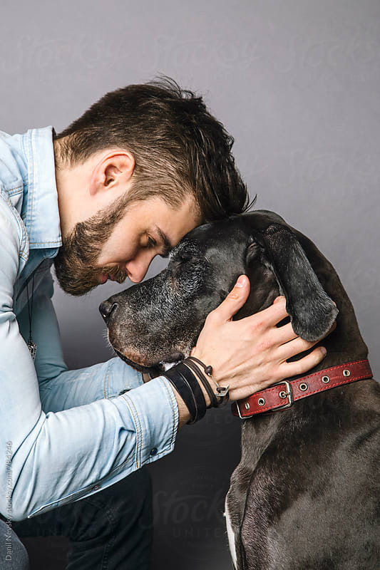 Man hug his German Dane by Danil Nevsky for Stocksy United