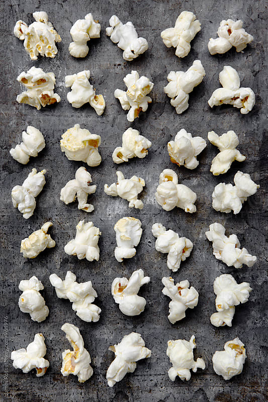 Pieces of popcorn by James Ross for Stocksy United
