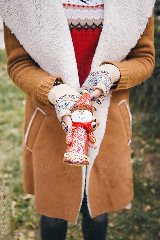 Woman's hands holding toy snowman by Danil Nevsky for Stocksy United