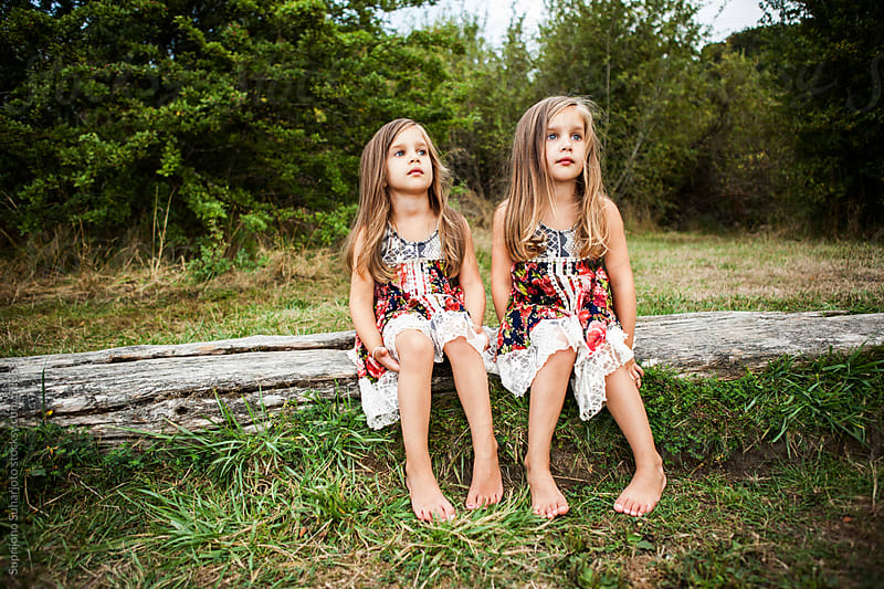 Portrait of twin sisters in a park by Suprijono Suharjoto for Stocksy United