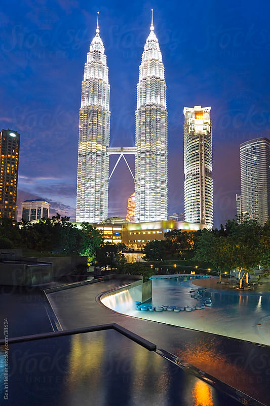Asia, Malaysia, Selangor State, Kuala Lumpur, Petronas Towers and Malaysian national flag - 88 storey steel clad twin towers with a height of 451.9 metres, iconic symbol of KL by Gavin Hellier for Stocksy United