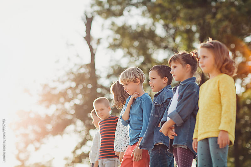 Group of Kids Standing Outdoors by Lumina for Stocksy United