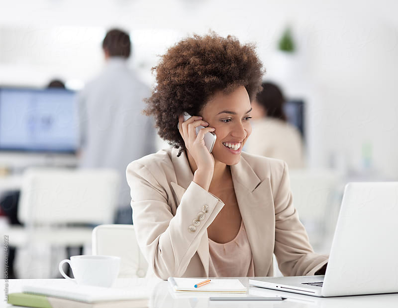 African Businesswoman Telephoning by Lumina for Stocksy United