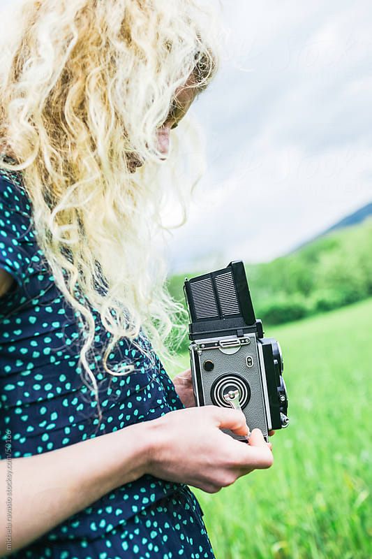 Woman using vintage camera by michela ravasio for Stocksy United