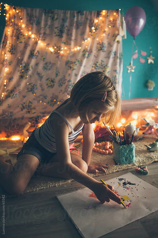 Girl Drawing in Her Room by Lumina for Stocksy United