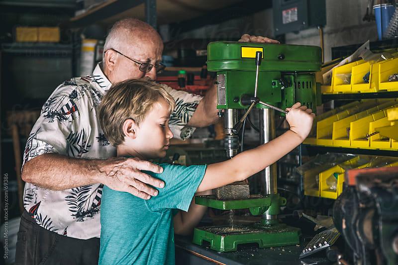 Grandfather teaching Grandson in Workshop by Stephen Morris for Stocksy United