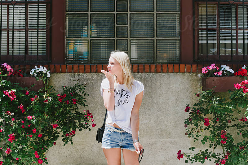 Blowing a kiss by Lauren Naefe for Stocksy United