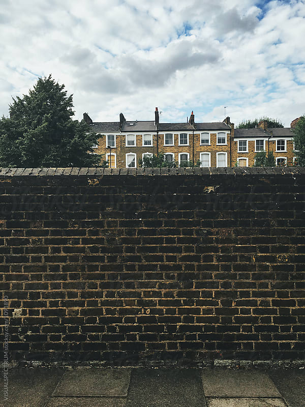 London Town Houses Behind Brick Wall by VISUALSPECTRUM for Stocksy United