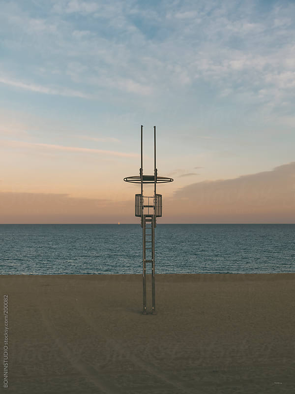 Sunset on a Barcelona beach. Lifeguard. by BONNINSTUDIO for Stocksy United
