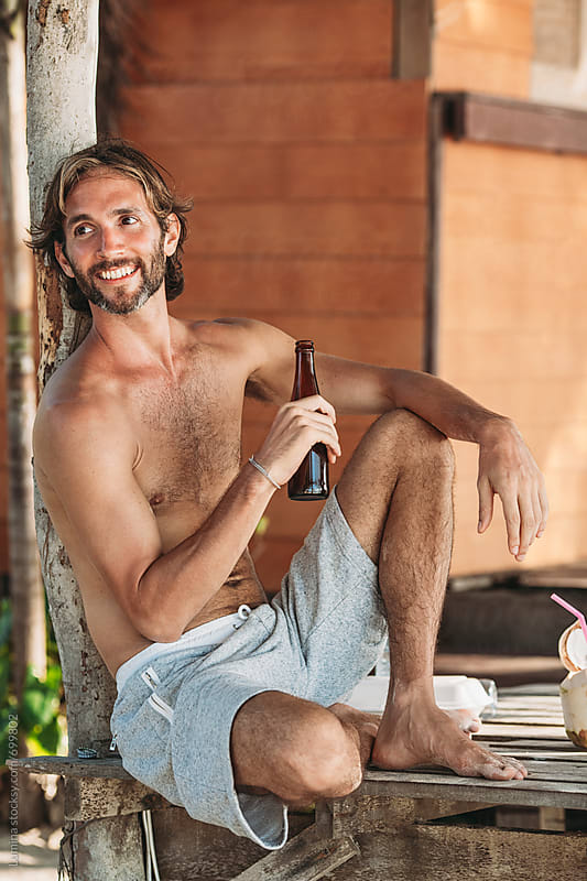 Smiling Man Drinking Beer by Lumina for Stocksy United