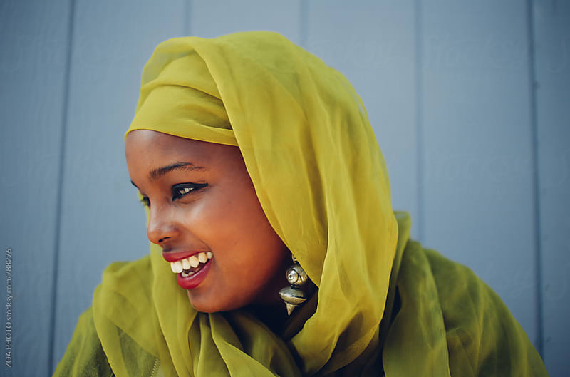 Somali-American woman with green hijab by ZOA PHOTO for Stocksy United
