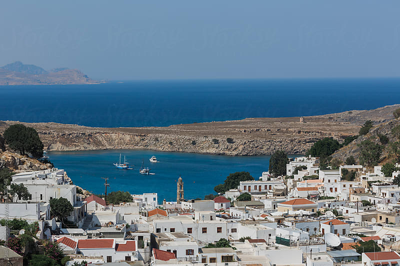 Small white houses of Lindos, Greece looking out to sea from an elevated position. by Paul Phillips for Stocksy United
