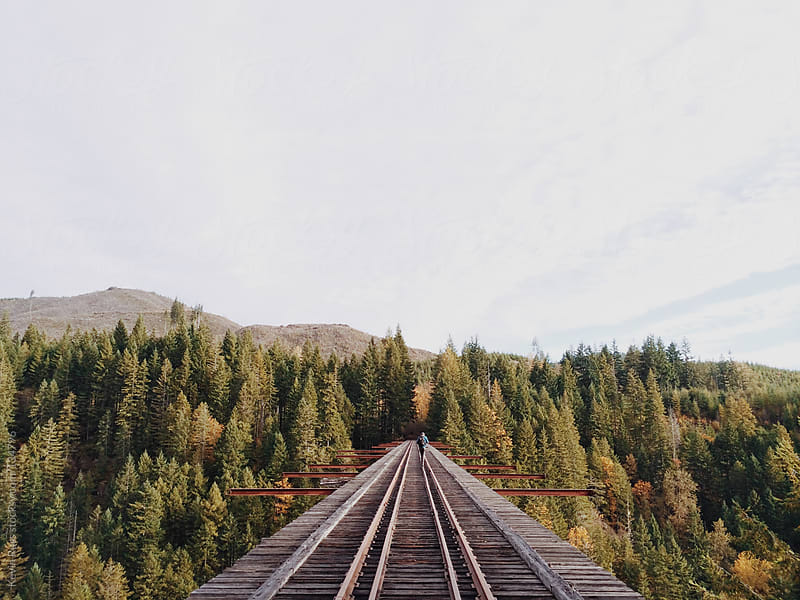 Man Walking on Abandoned Train Trestle by Kevin Russ for Stocksy United