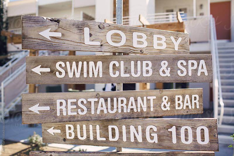 Wood sign at hotel by Jeff Marsh for Stocksy United