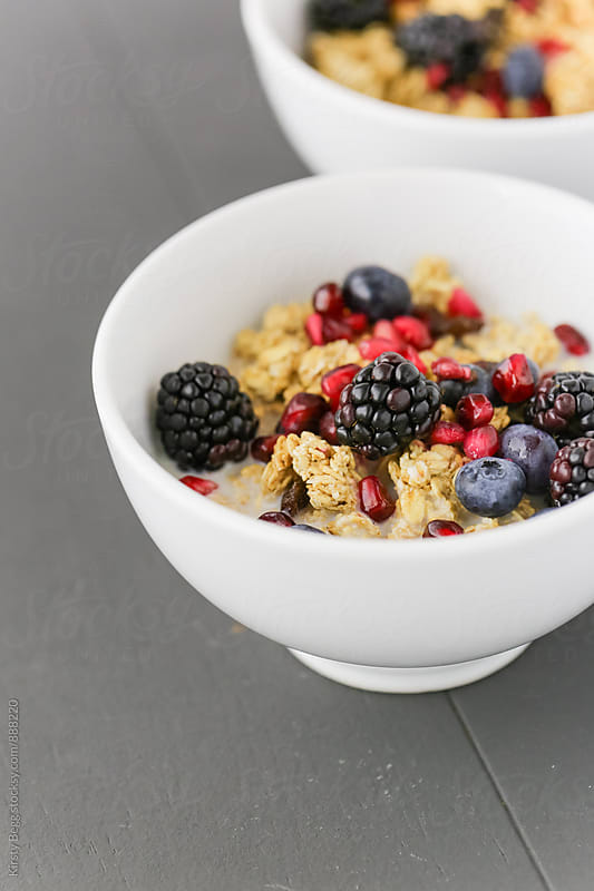 Breakfast of granola and fresh fruit by Kirsty Begg for Stocksy United