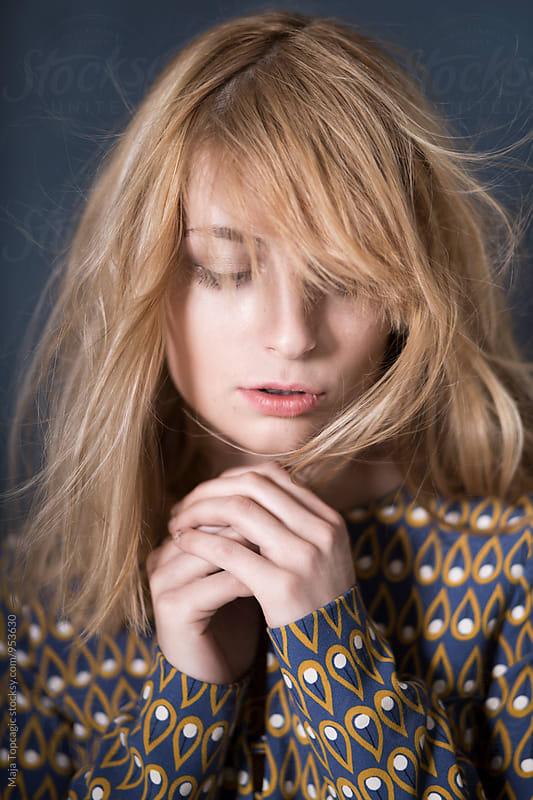 Portrait of a beautiful woman in studio by Maja Topcagic for Stocksy United