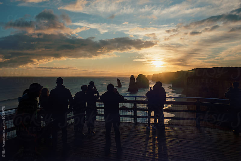 tourist at sunset, shooting the 12 Apostles along the great ocean road by Gillian Vann for Stocksy United