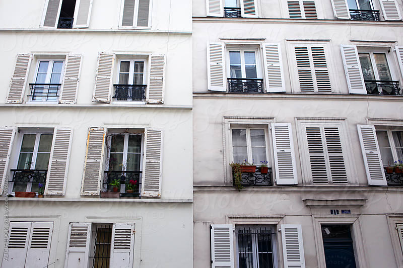 Shuttered Windows Of A Paris Apartment Building by ALICIA BOCK for Stocksy United