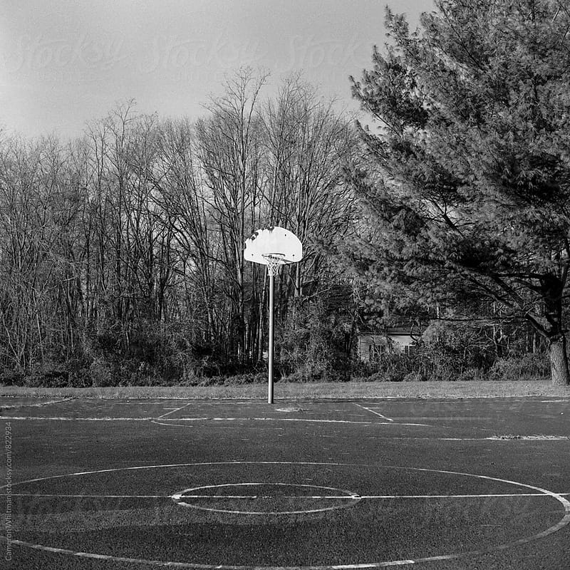 Dilapidated Basketball Court  by Cameron Whitman for Stocksy United