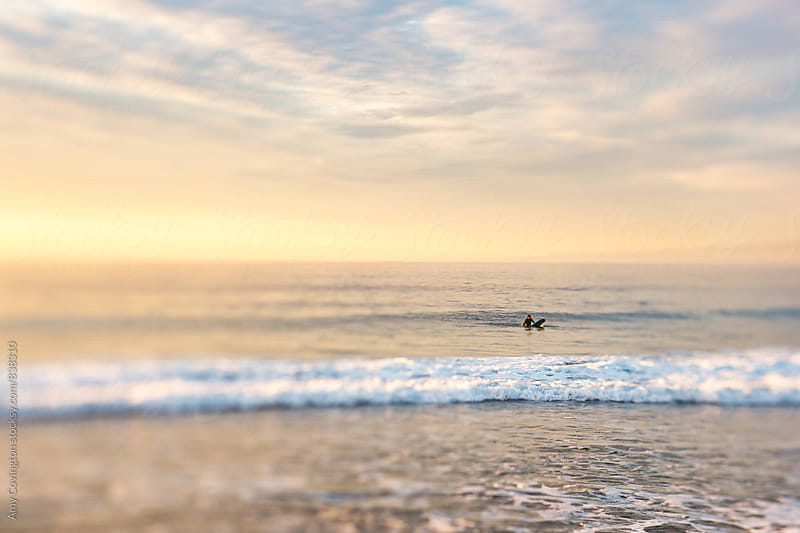 Surfer waiting for a wave by Amy Covington for Stocksy United