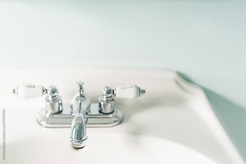 Bathroom or lavatory faucet. by Melissa Ross for Stocksy United