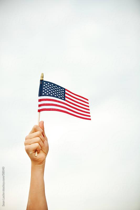 Flag: Hand Holding United States Flag by Sean Locke for Stocksy United