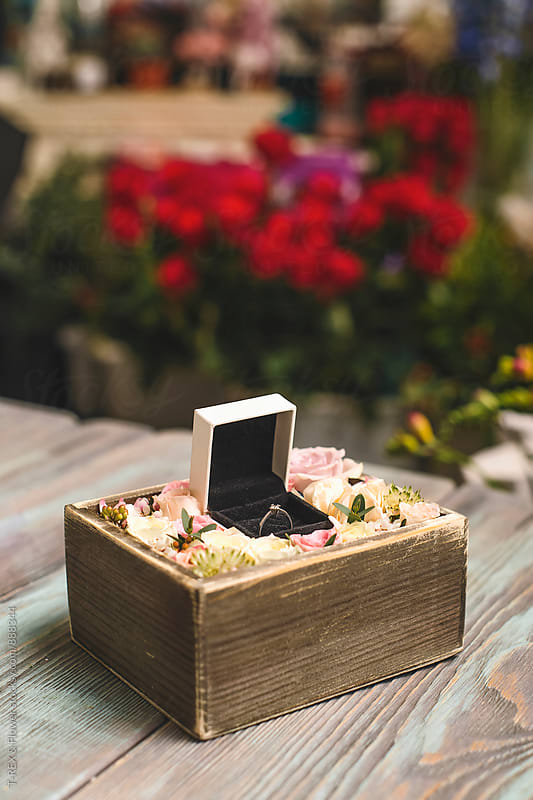 Close-up of engagement ring in wooden box with roses by Danil Nevsky for Stocksy United