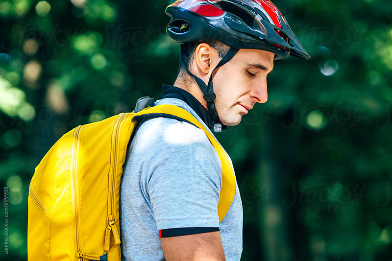 Man With a Bike Helmet  by Lumina for Stocksy United