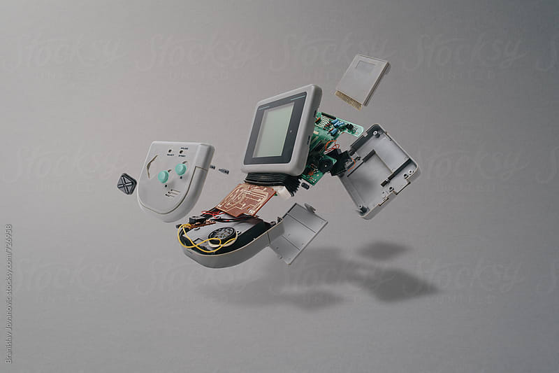 Disassembled Portable Gaming Console by Branislav Jovanović for Stocksy United