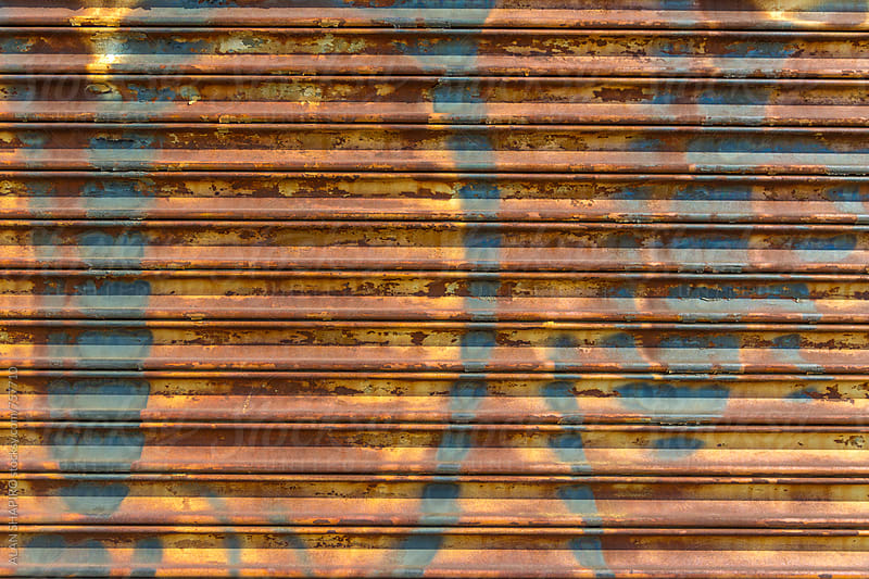 Colorful painted corrugated wall by ALAN SHAPIRO for Stocksy United