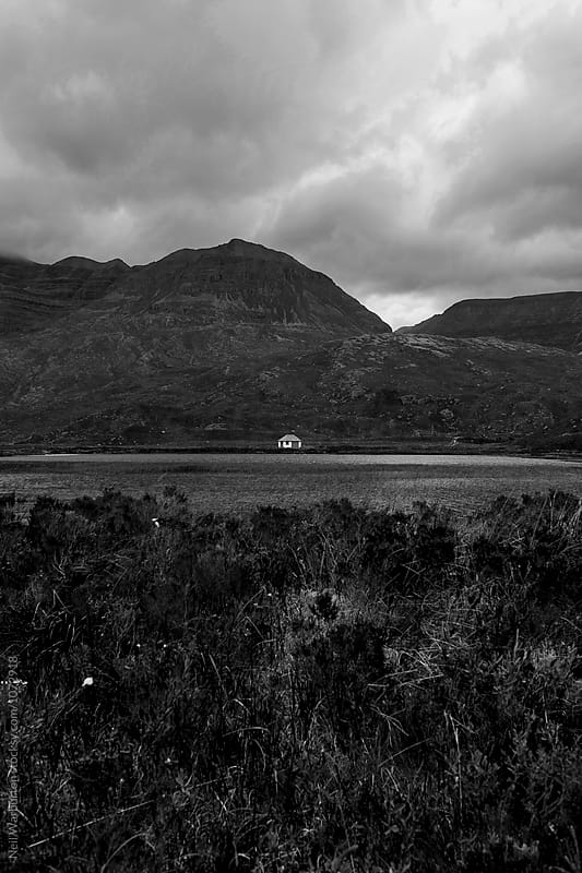 Small remote cottage in the highlands of Scotland by Neil Warburton for Stocksy United
