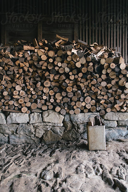 Stack of firewood by Pixel Stories for Stocksy United
