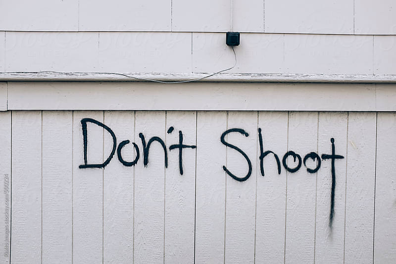 The words DON'T SHOOT spray painted on building exterior by Paul Edmondson for Stocksy United