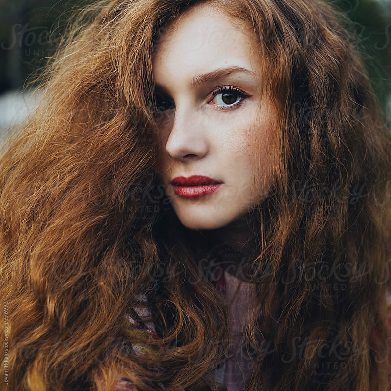 Portrait of a beautiful ginger woman with freckles by Jovana Rikalo for Stocksy United