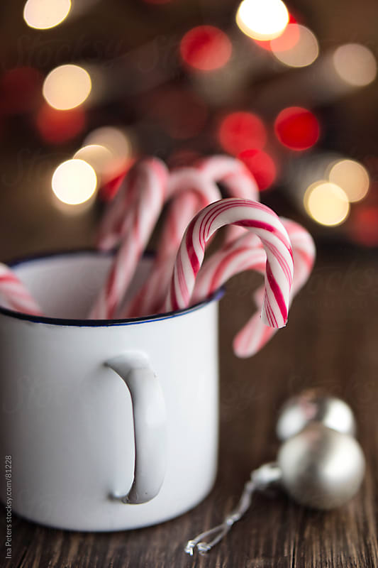 Candy Canes in a mug by Ina Peters for Stocksy United