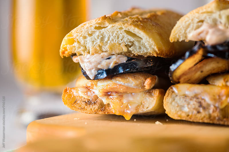 Chicken Sandwhich with Eggplant Crisps  by Jeff Wasserman for Stocksy United